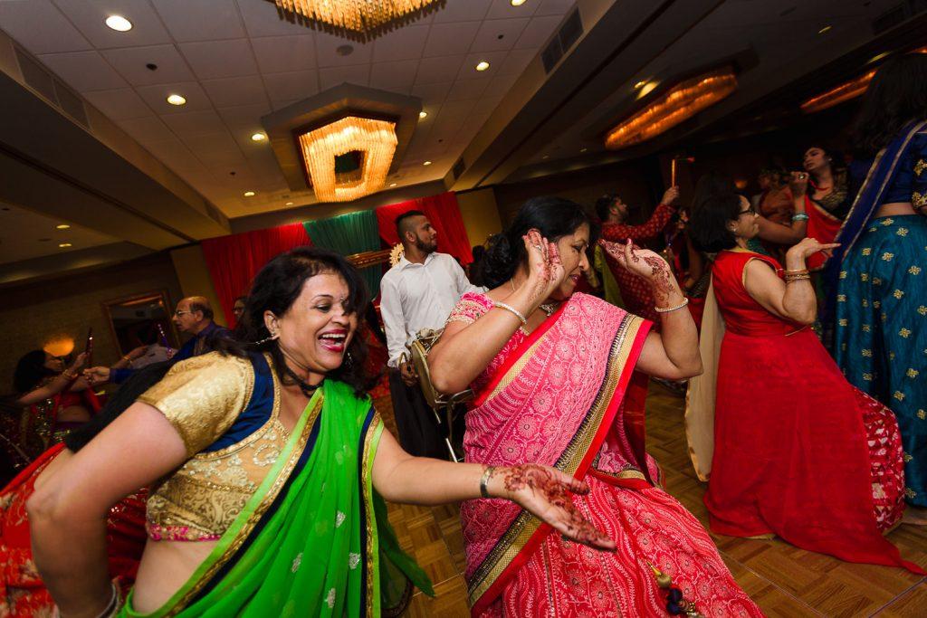 women in saris dancing