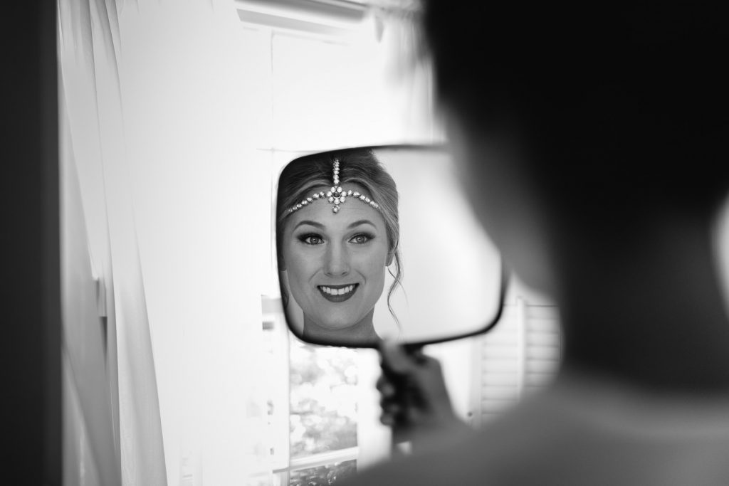 bride looks in mirror