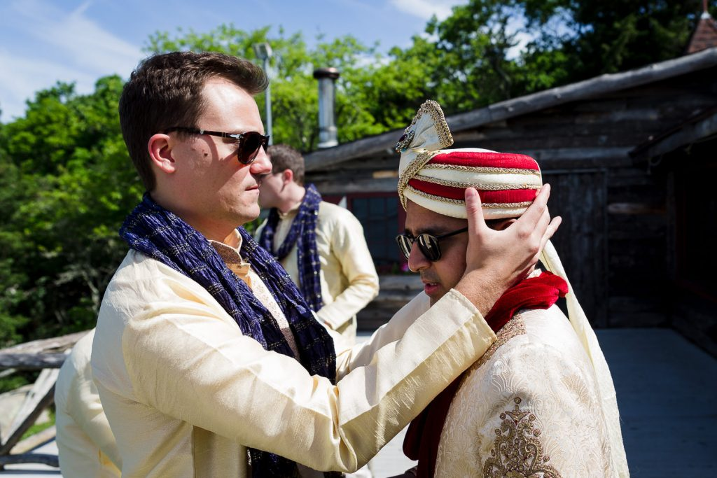 groom puts on indian turban