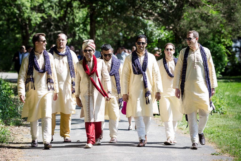 indian groom and friends walk to baraat ceremony