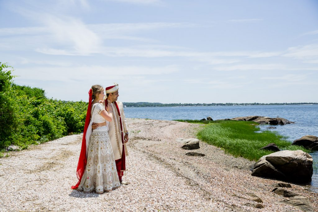 indian bride and groom on beach in bristol ri