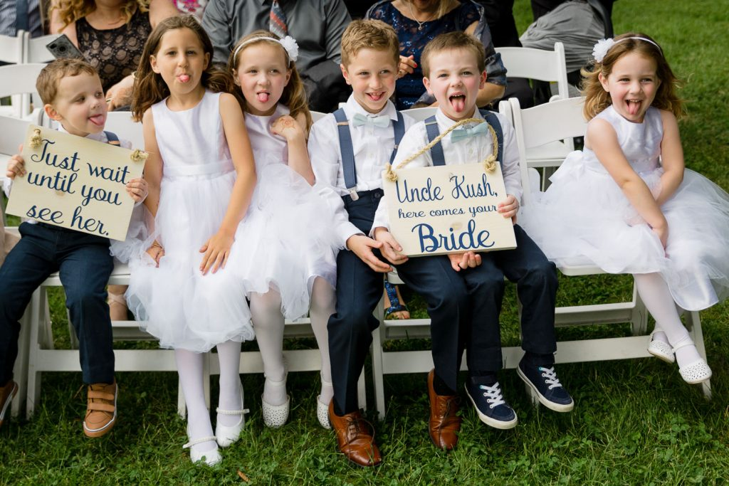cute kids hold a wedding sign