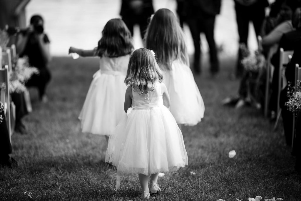 flower girls walk down aisle