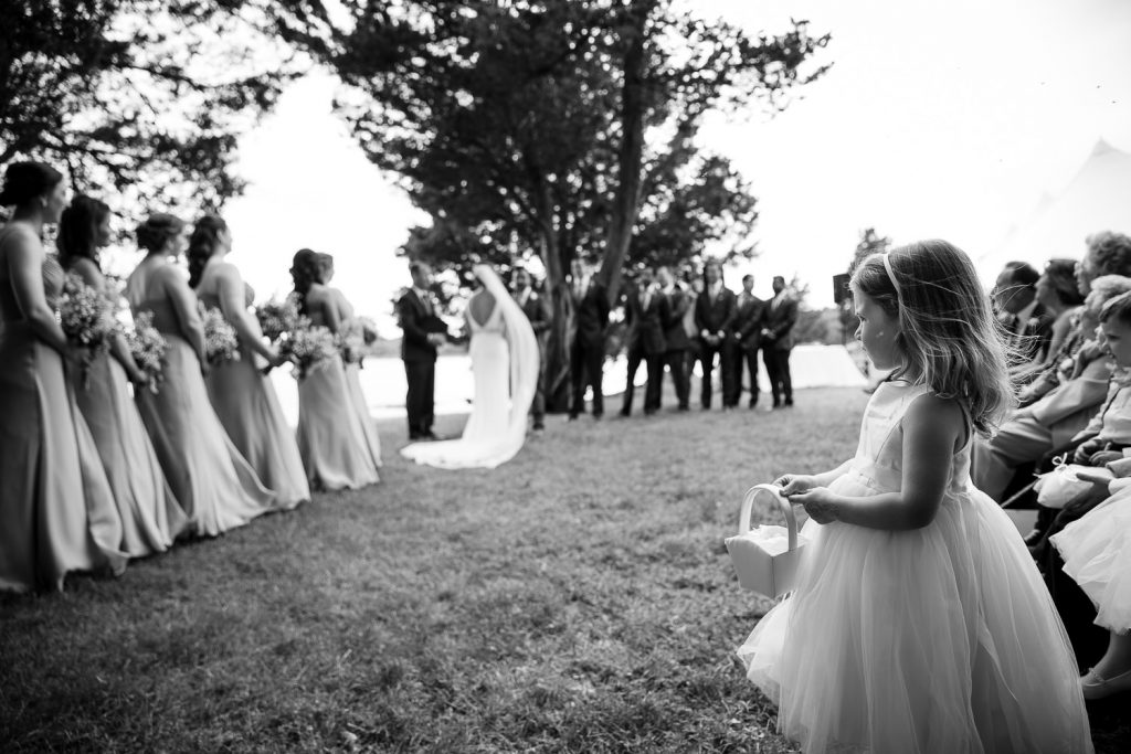 flower girl watches wedding ceremony