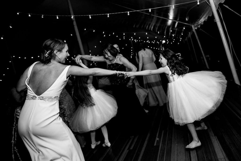 bride spins flower girl on dance floor
