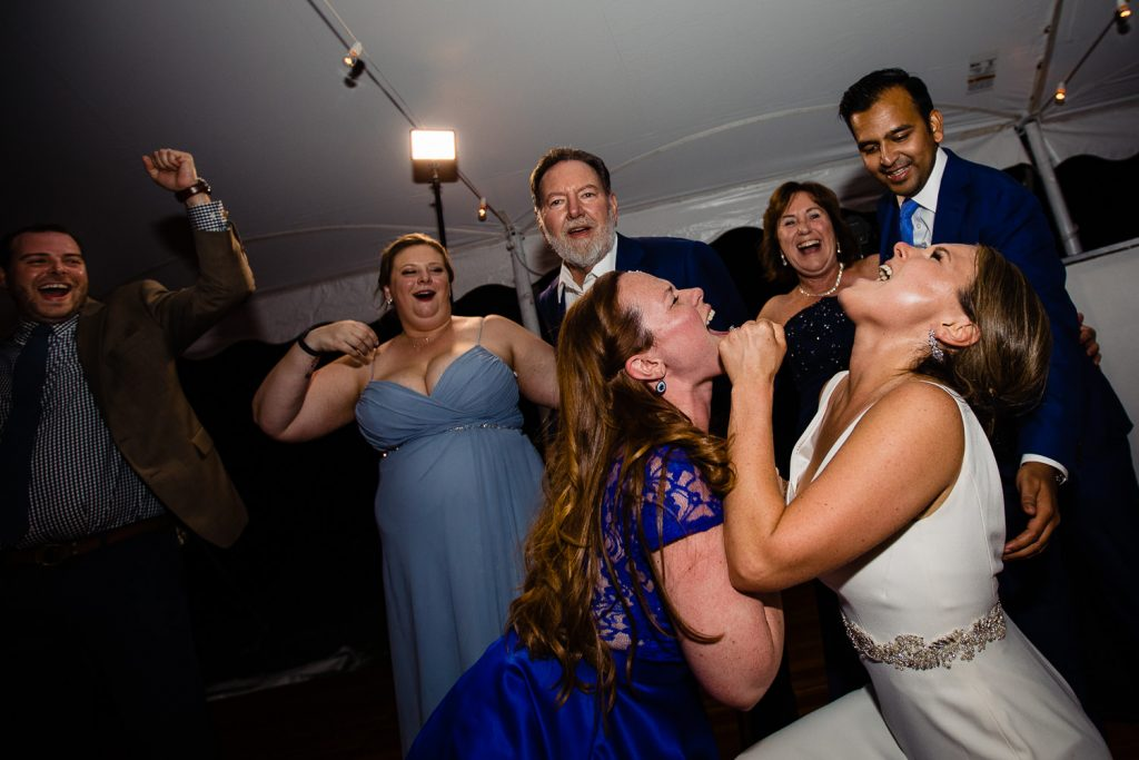 bride emphatically singing at tent wedding