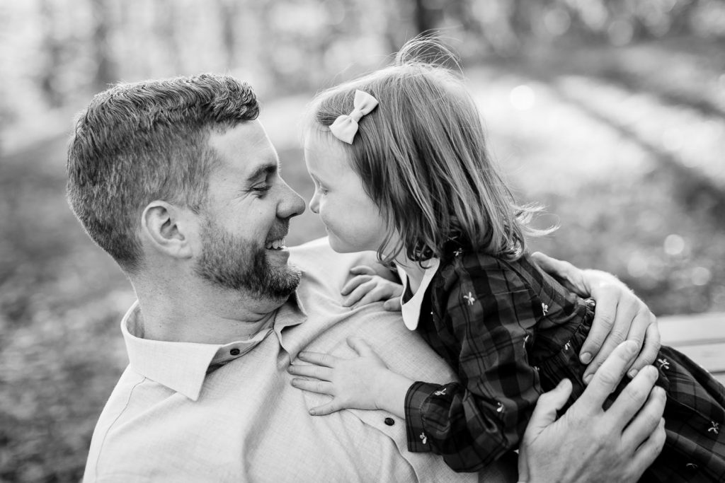 A little girl goes nose to nose with her dad