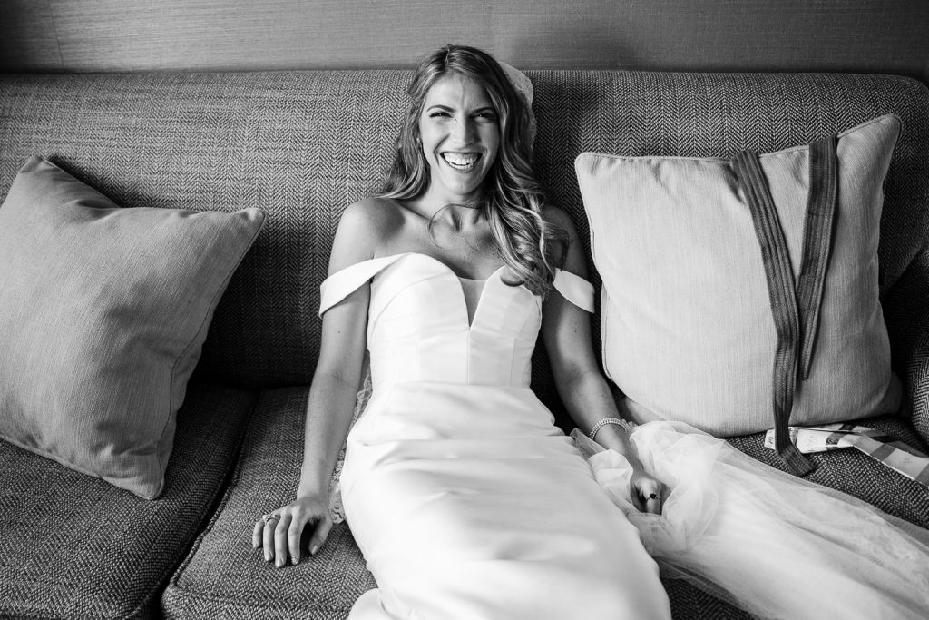 bride on couch in castle hill in bridal suite