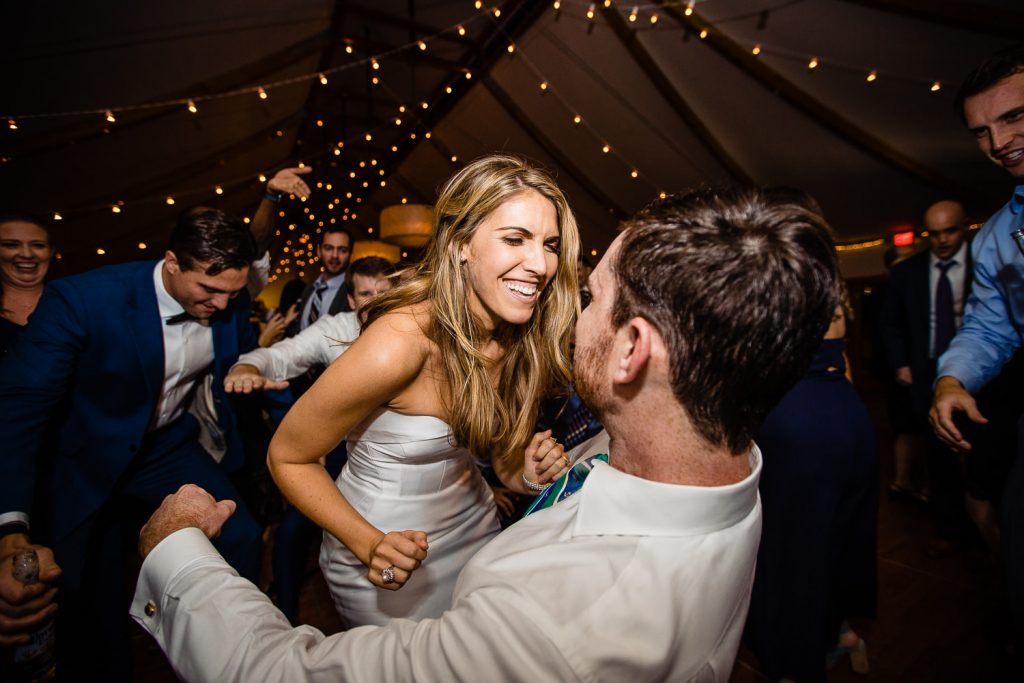 bride and groom dancing at tent wedding