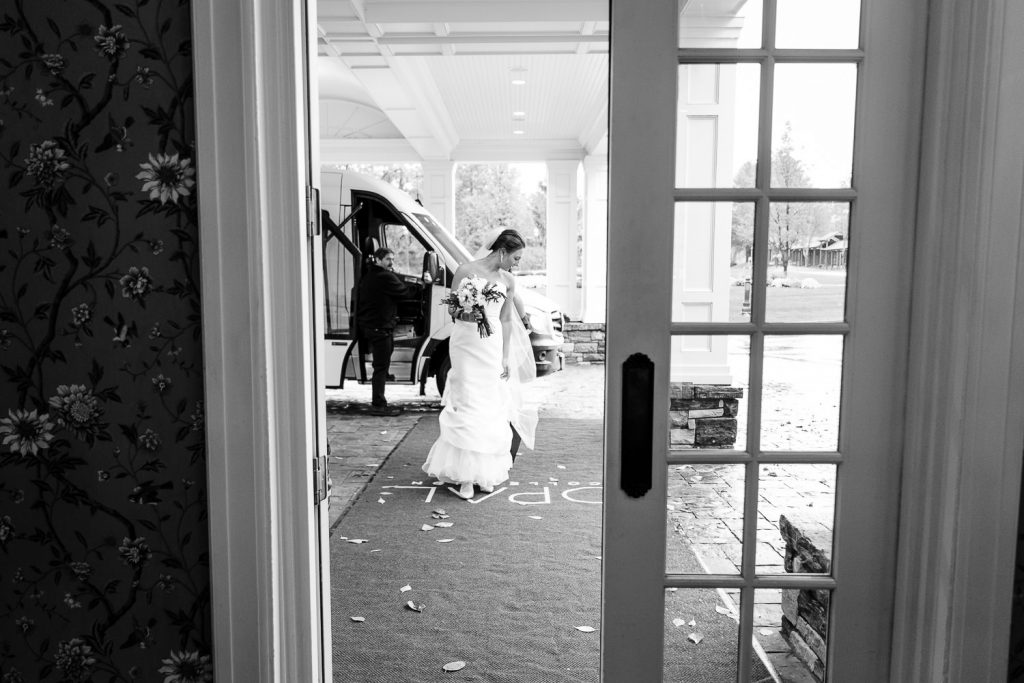The bride walks in the front door of the Sagamore resort on lake george