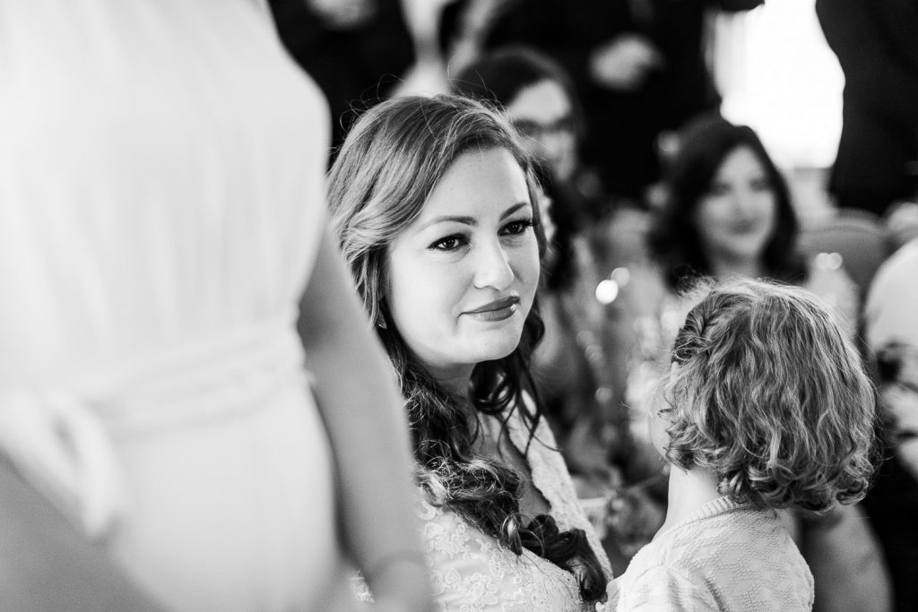 A friend tears up seeing her friends do their wedding first look