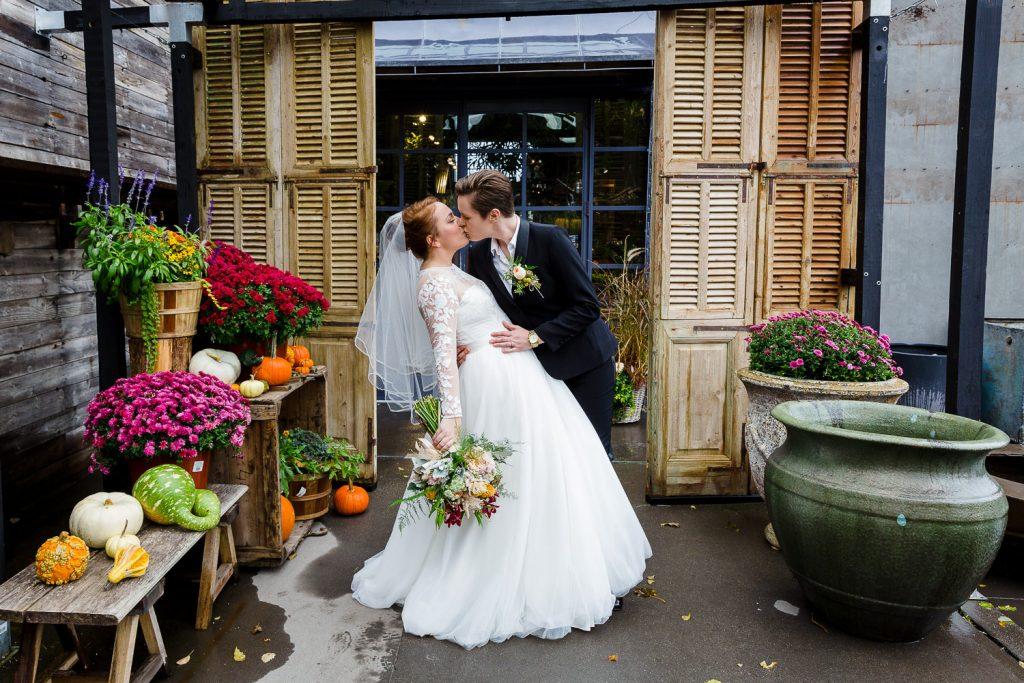 A bride dips her partner in front of Terrain garden store in westport ct at their wedding