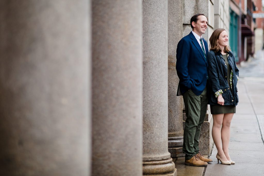 A man and woman outside the stone pillars of the providence superior court