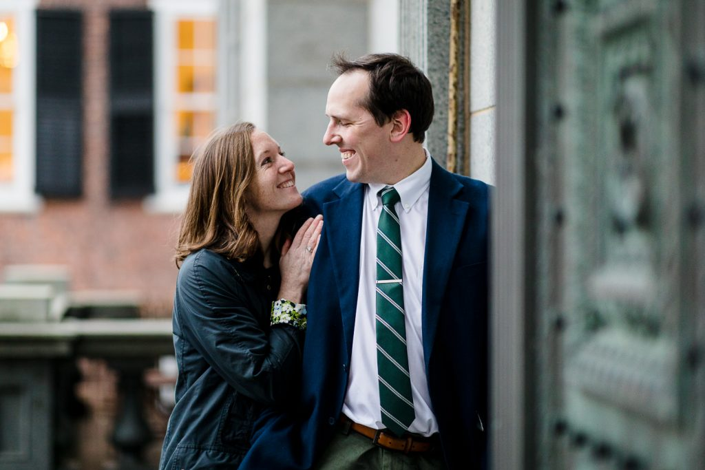 A woman looks up lovingly into a mans eyes in downtown providence ri engagement photos