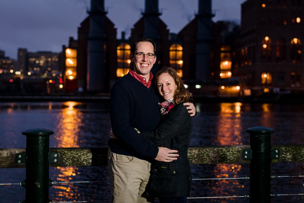 Night engagement photos in front of the providence power plant