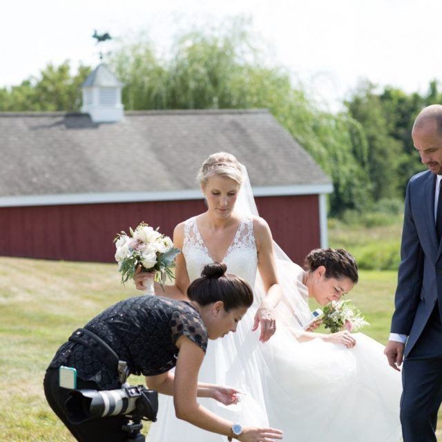 wedding photographer picks bugs out of a brides dress in woodstock ct