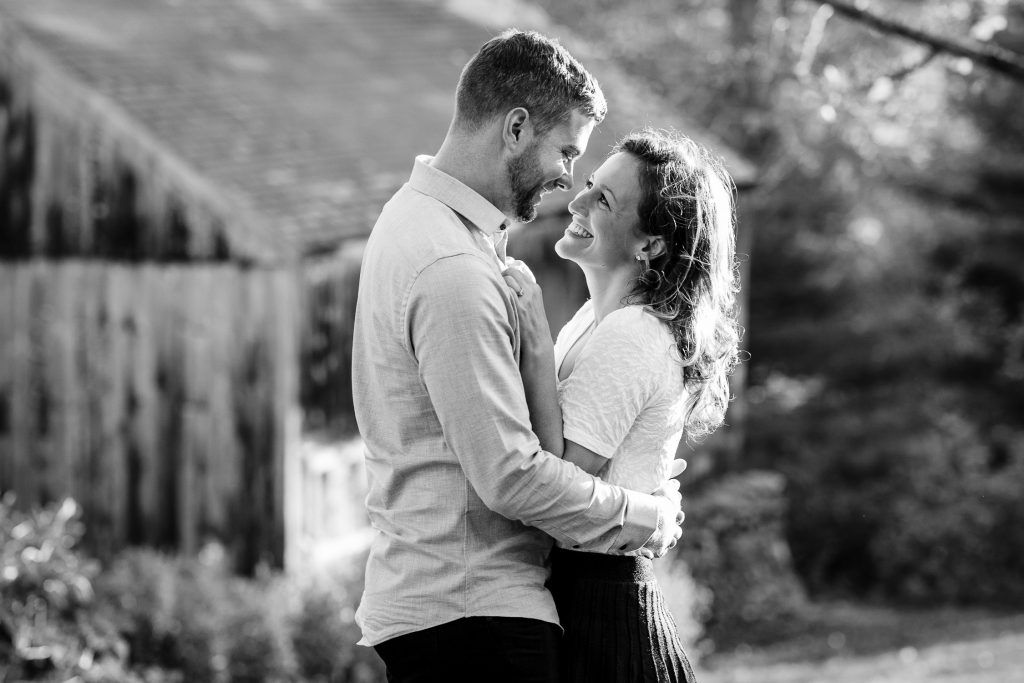 Couple embraces during central ma engagement session