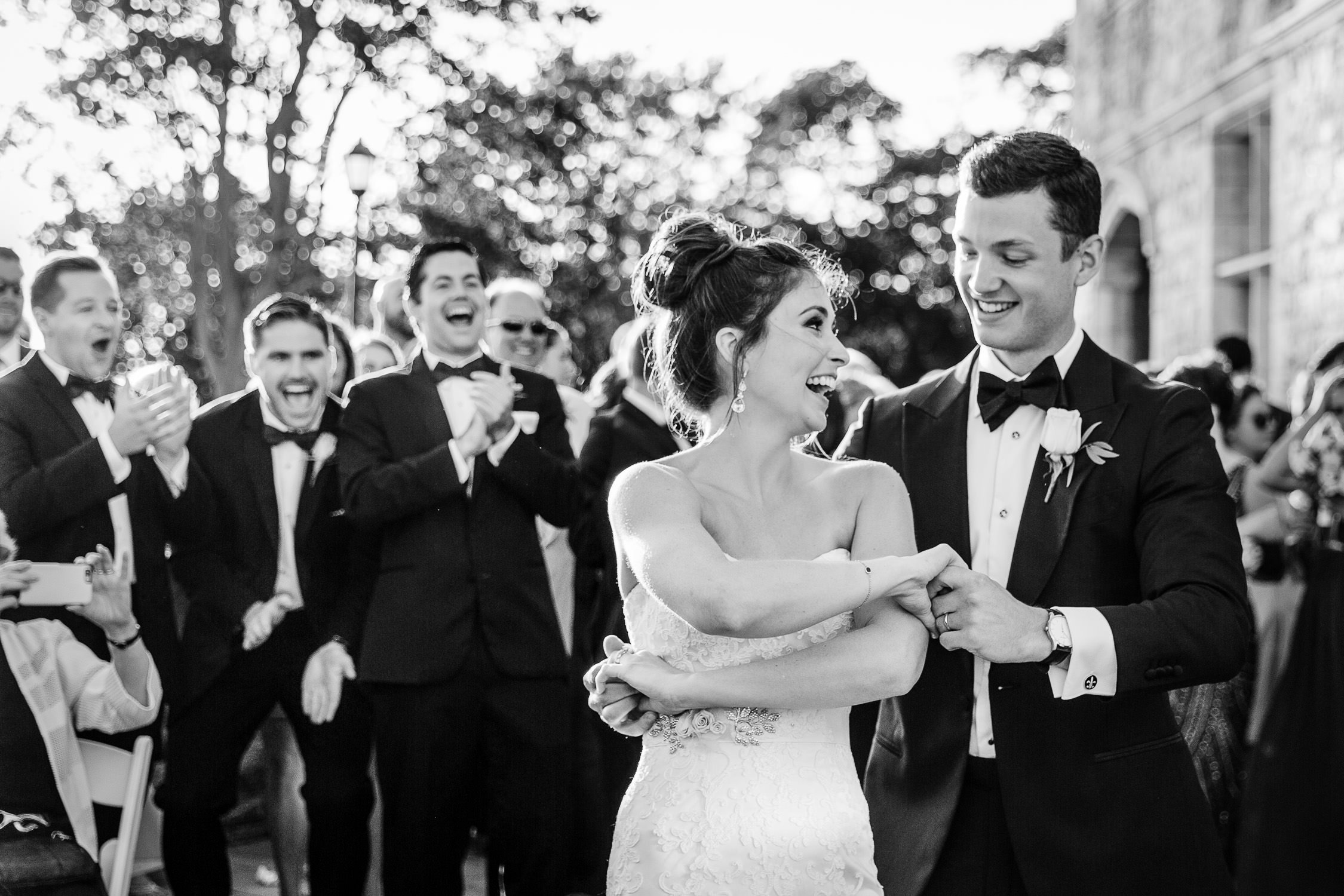 Three brothers laugh at wedding couple dancing at connecticut mansion wedding