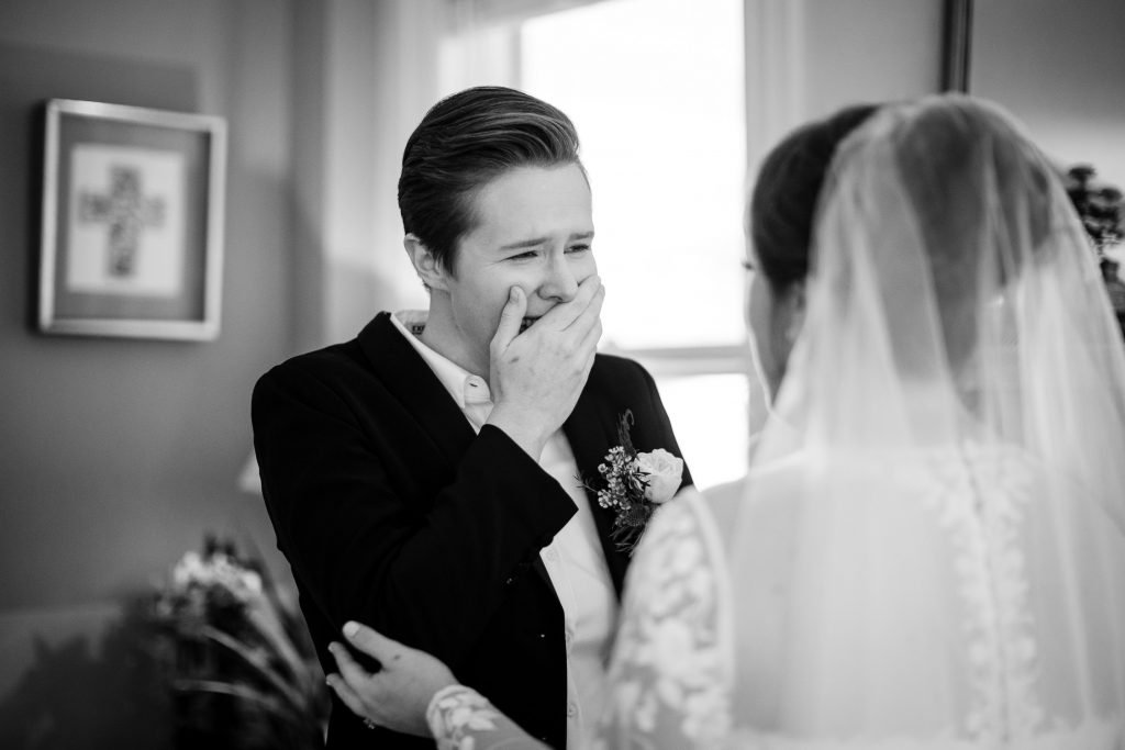 Bride is emotional during first look with girlfriend