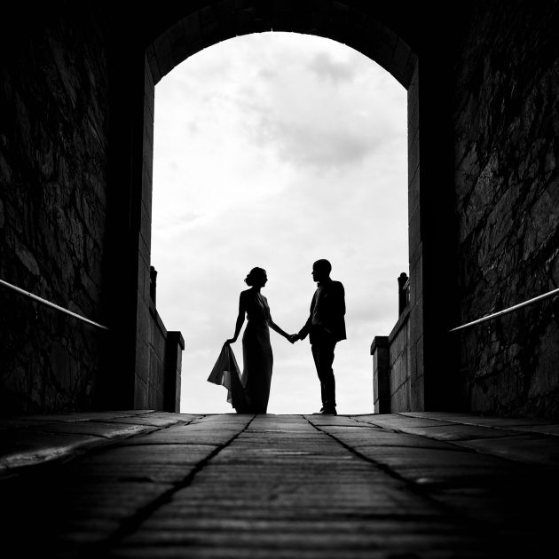 A silhouette of a bride and groom in a tunnel at fort adams in newport ri