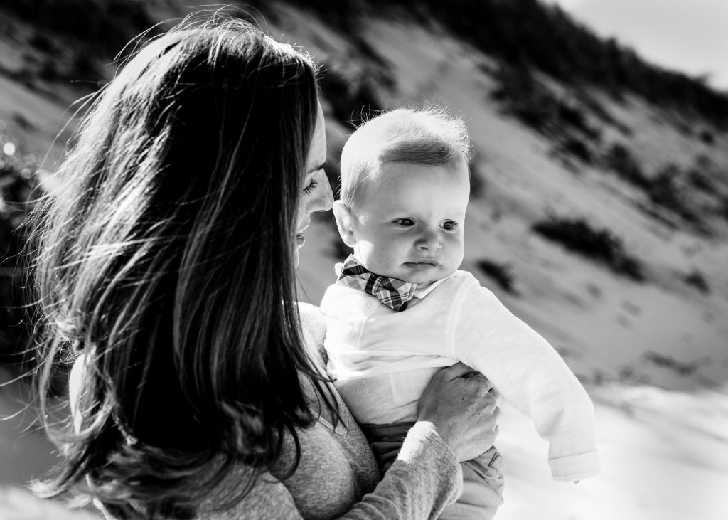 Mom holds baby at newcomb hollow welllfleet photo session