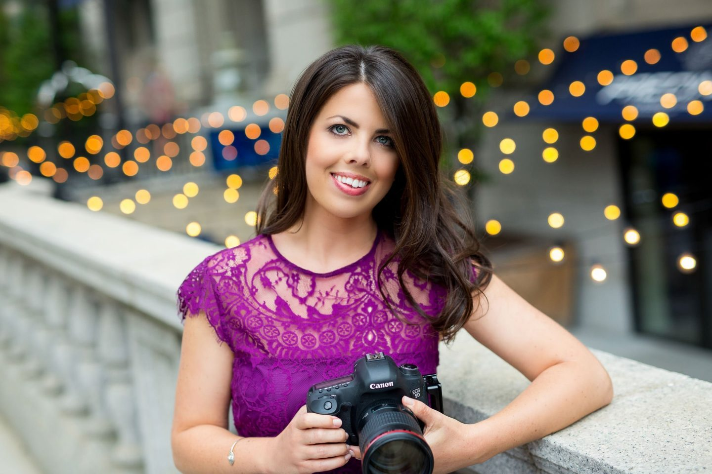 headshot of wedding photographer in purple lace dress in downtown boston ma