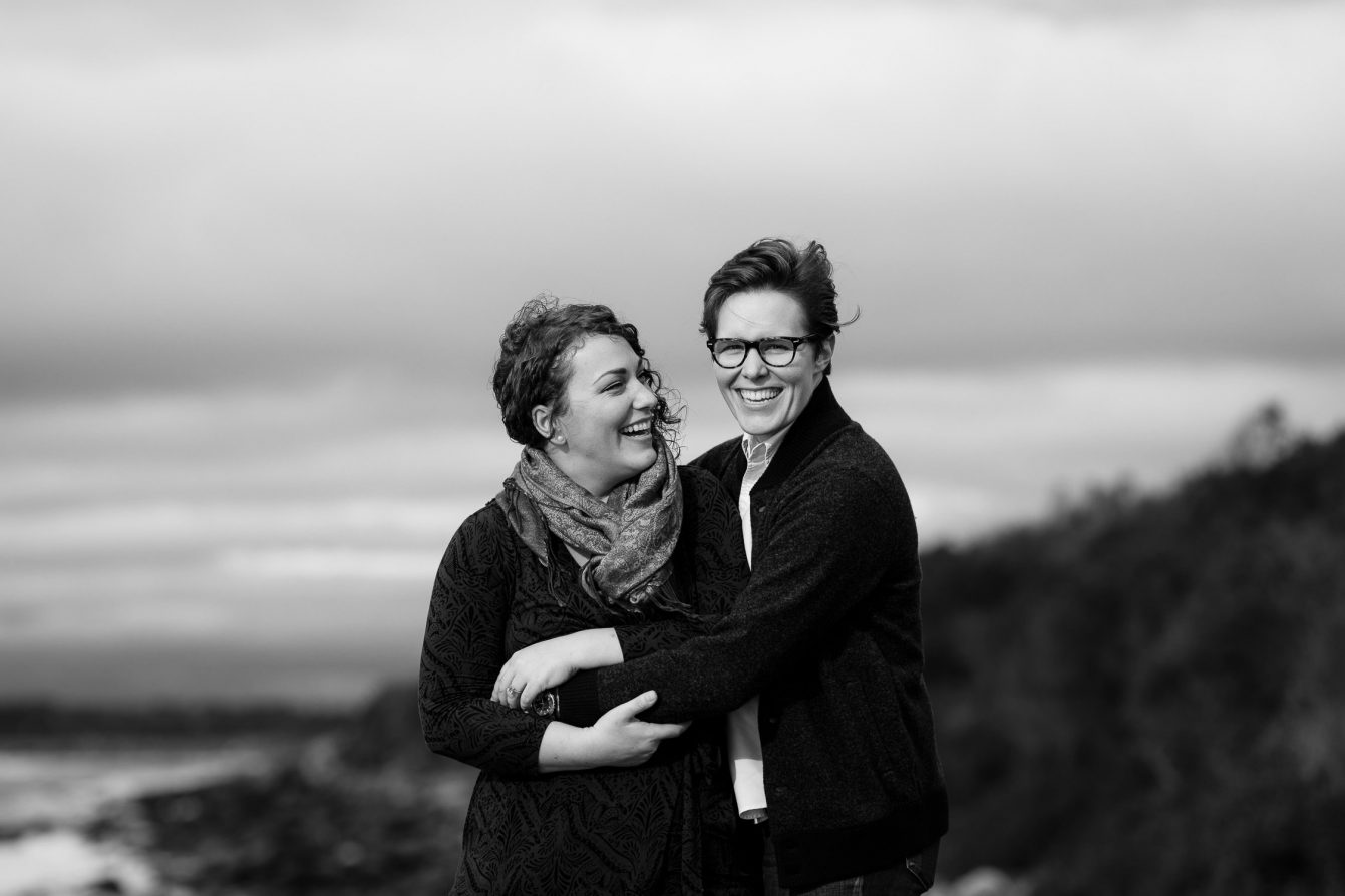 Couple embraces at sachuest point in newport ri during their engagement session