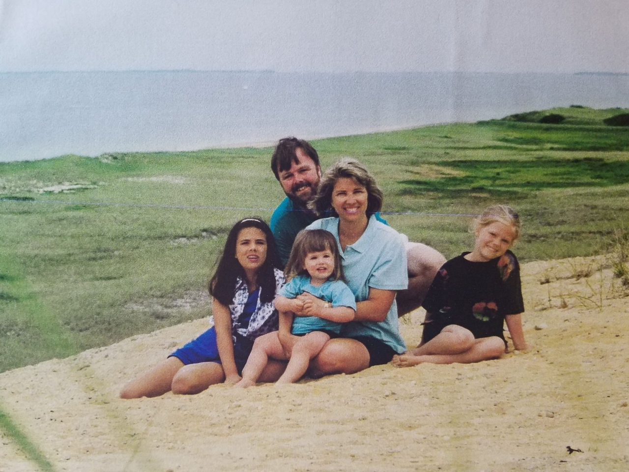 Mom, dad and three daughters pose for family photo on dune in Wellfleet, MA