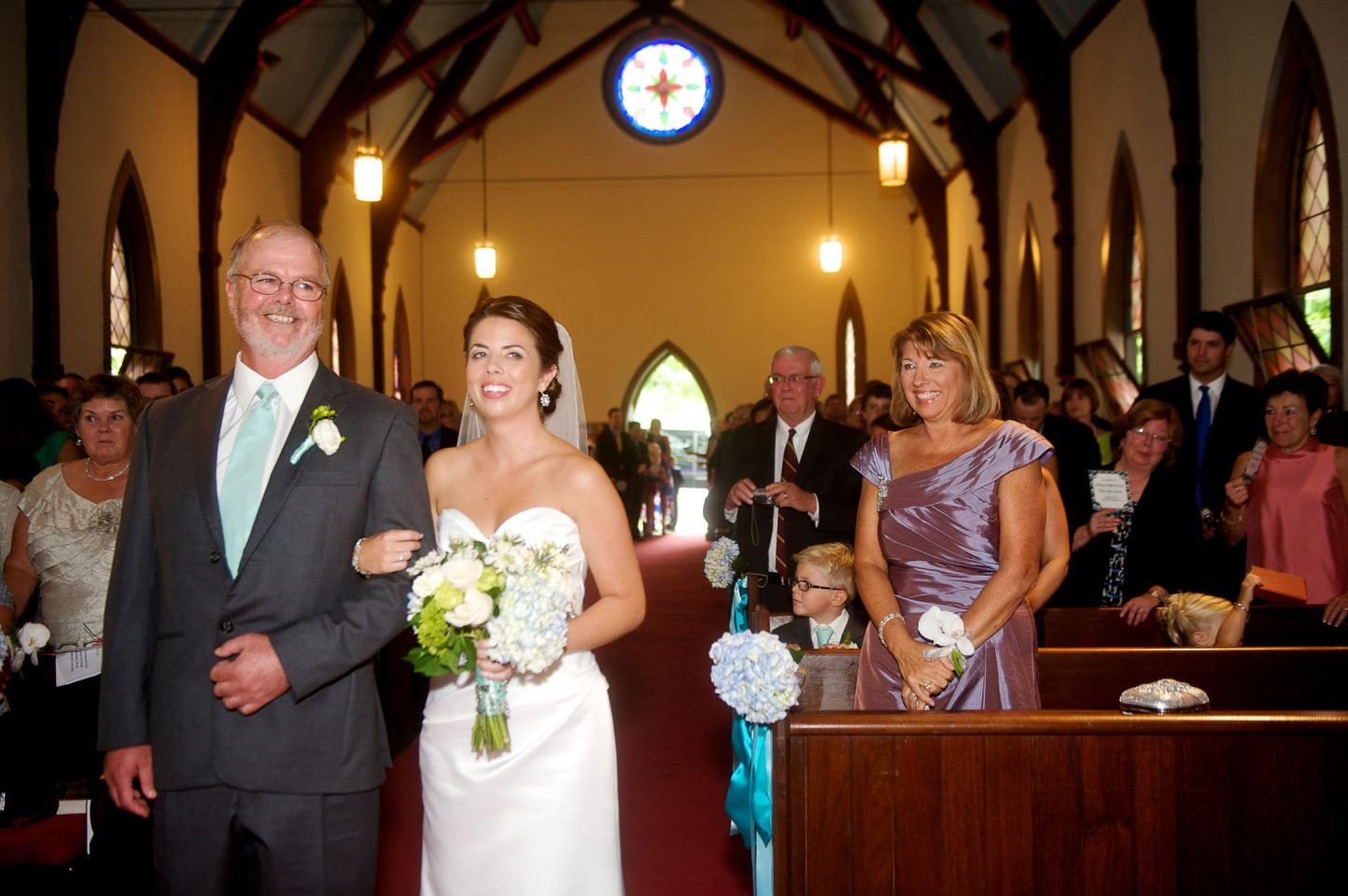 Mom looks on as father and daughter walk down the aisle at Pequote Chapel wedding ceremony