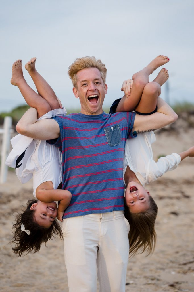 Man laughs holding nieces upside down at mayo beach wellfleet photos