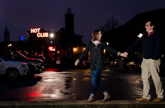 Woman drags man to Hot Club during downtown Providence RI engagement photo session