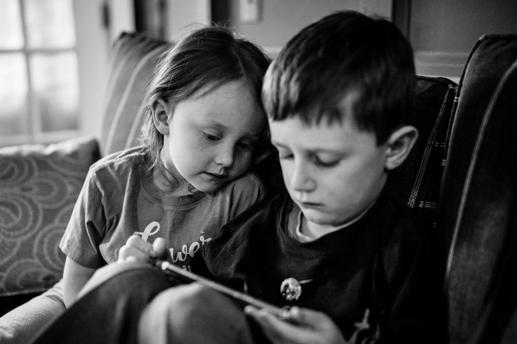 Two children watching an ipad before a wedding