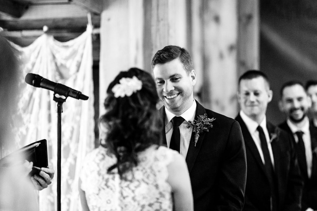 The groom looks lovingly at his bride during their wedding ceremony