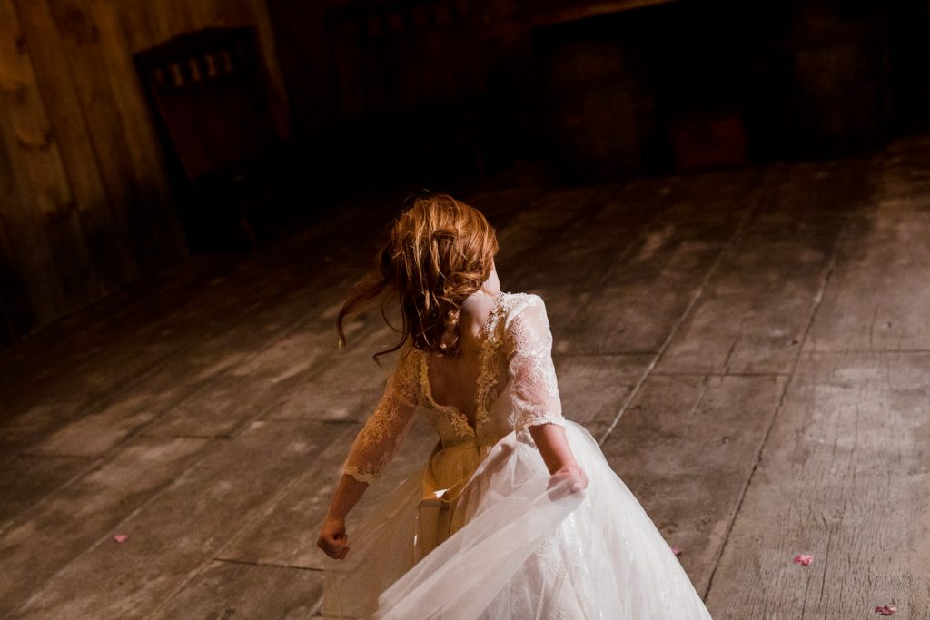 A flower girl runs wild in the barn at five bridge inn