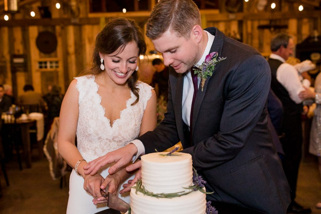 A bride and groom cut their cake
