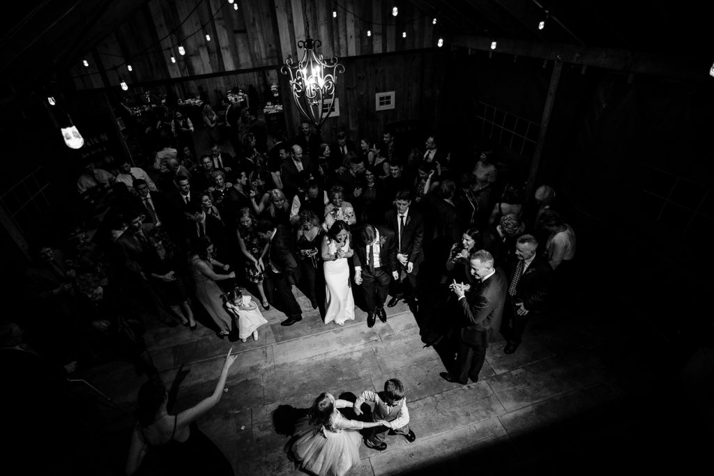 A view from above of the dance floor at a five bridge inn barn wedding