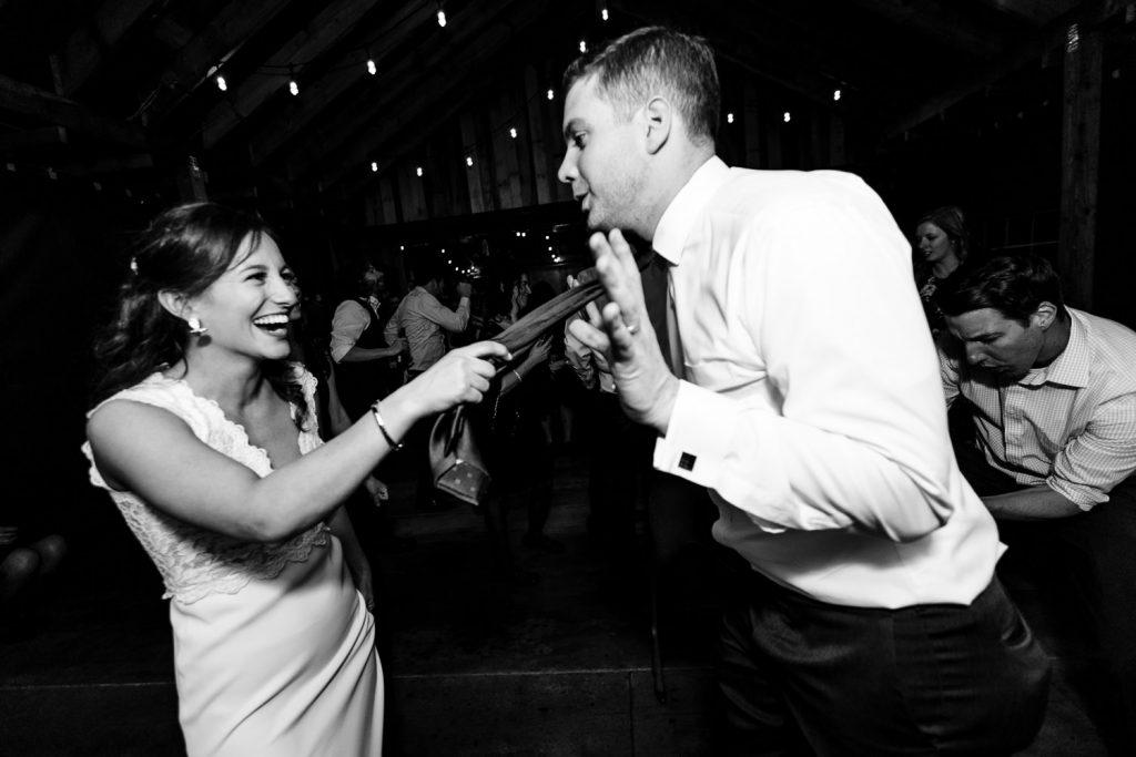 A bride pulls her grooms tie
