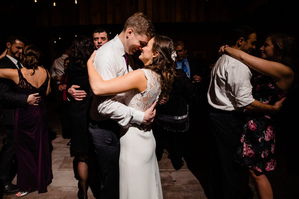 A bride and groom dancing in the barn at five bridge inn