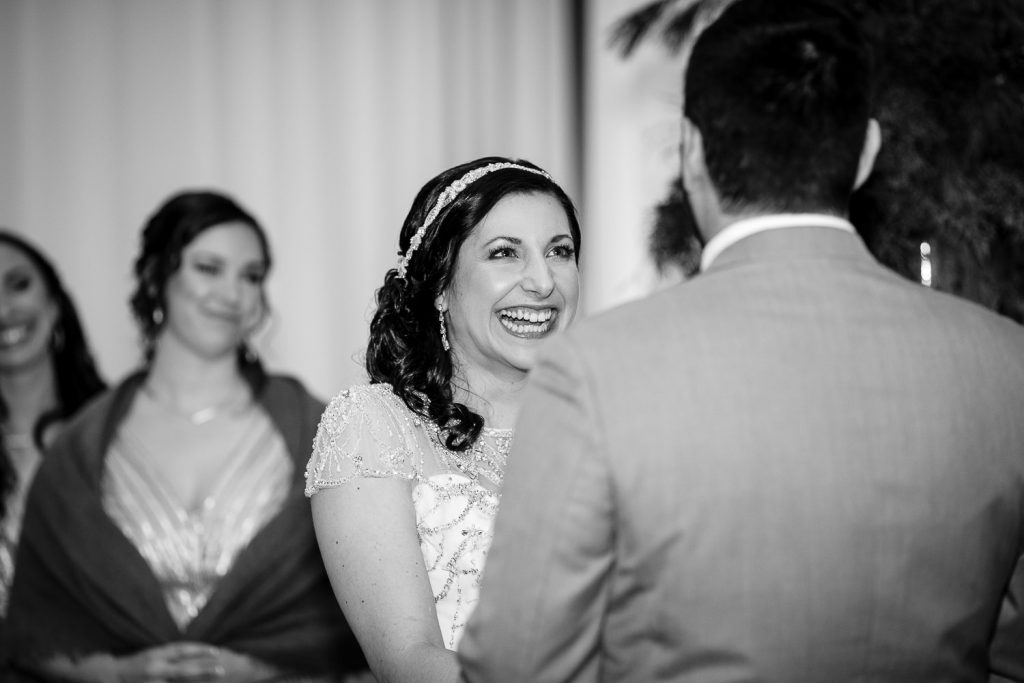 A bride has a huge smile on her face as she marries her groom