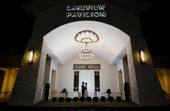 Tiny bride and groom silhouette in front of lakeview pavilion wedding in foxborough ma