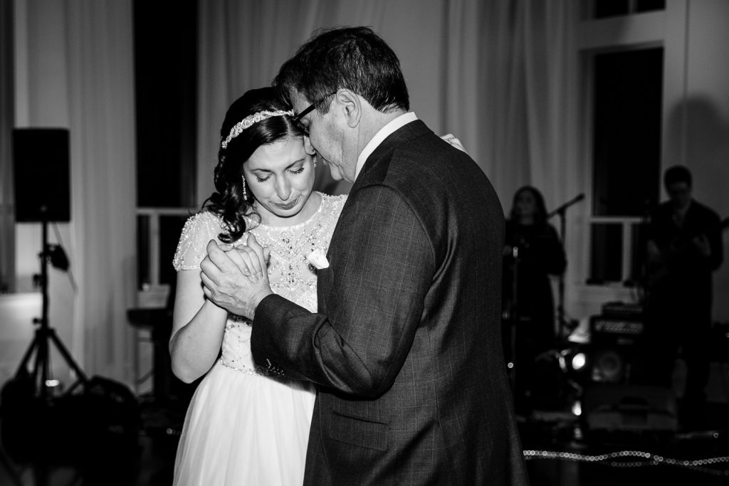 A bride is emotional as she dances with her father at her wedding