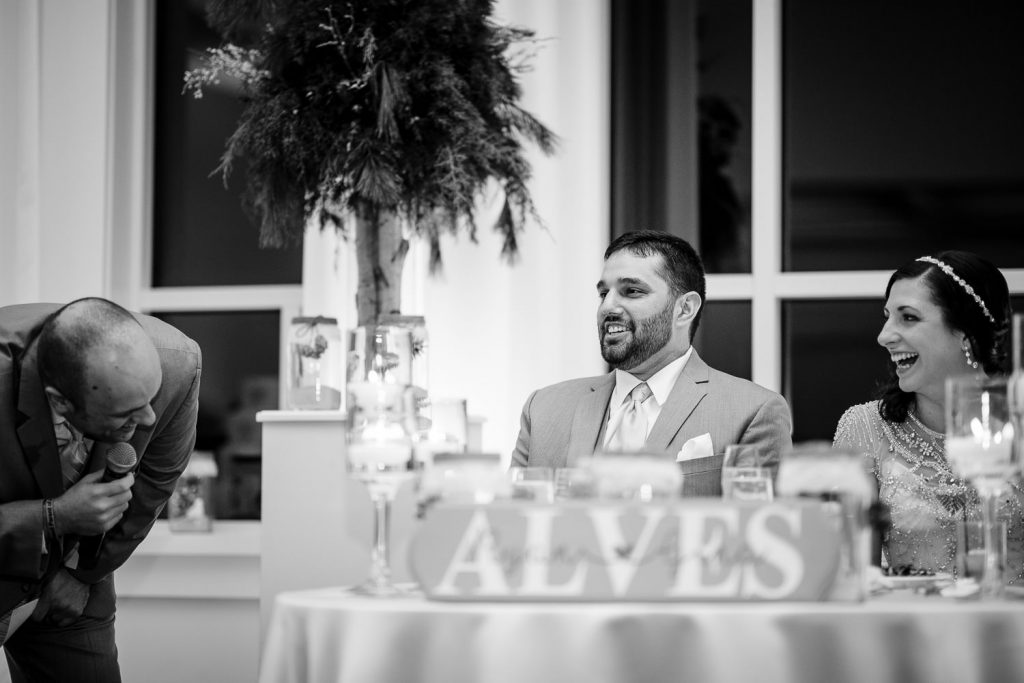 A bride and groom react to their wedding speech