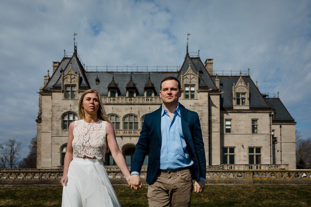 A man and woman walk away from Ochre Court