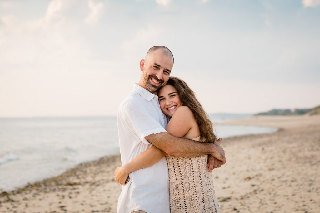 A father and daughter hug on duck harbor beach in wellfleet ma