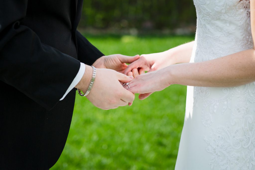 A bride and groom hold hands during their wedding first look