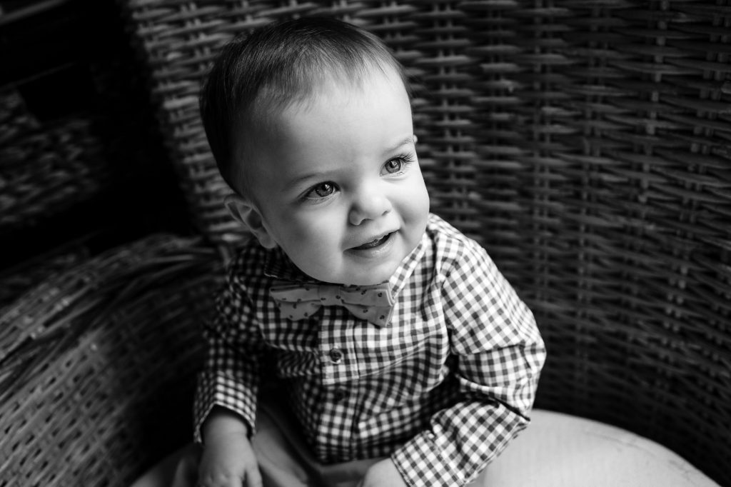 Little boy wearing a checked shirt with bowtie during rhode island family photo session