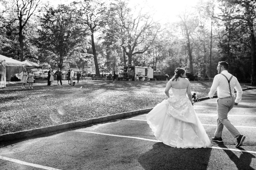The bride and groom dance across the parking lot to their cocktail hour