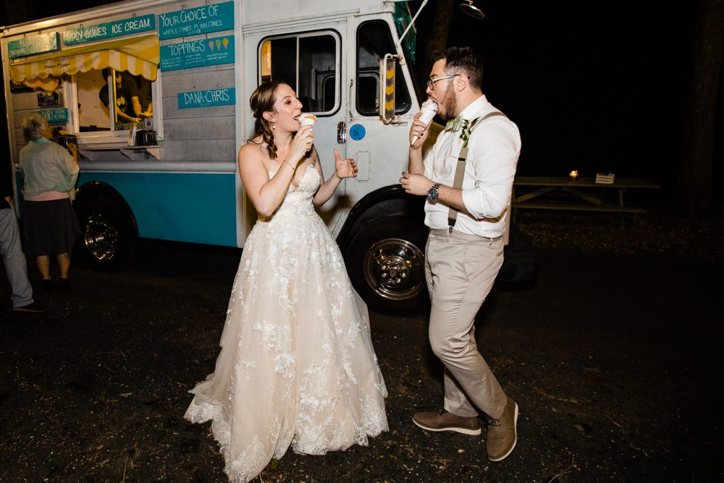A bride and groom eat tipsy cones ice cream truck at their stamford ct wedding