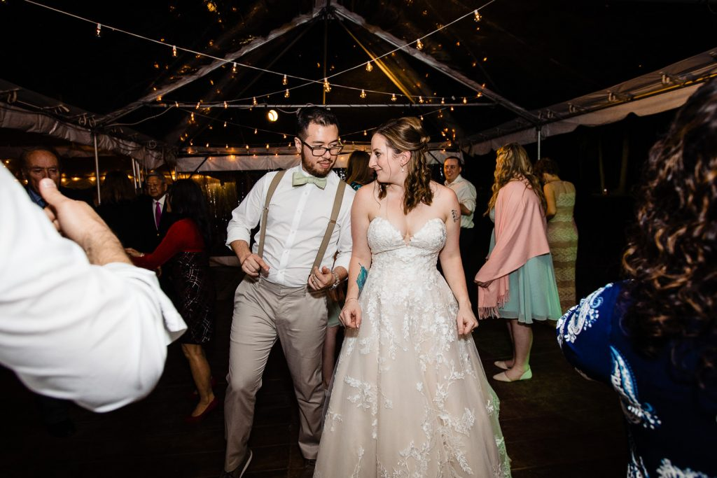 A bride and groom rub shoulders on the dance floor at their tented wedding reception in stamford ct