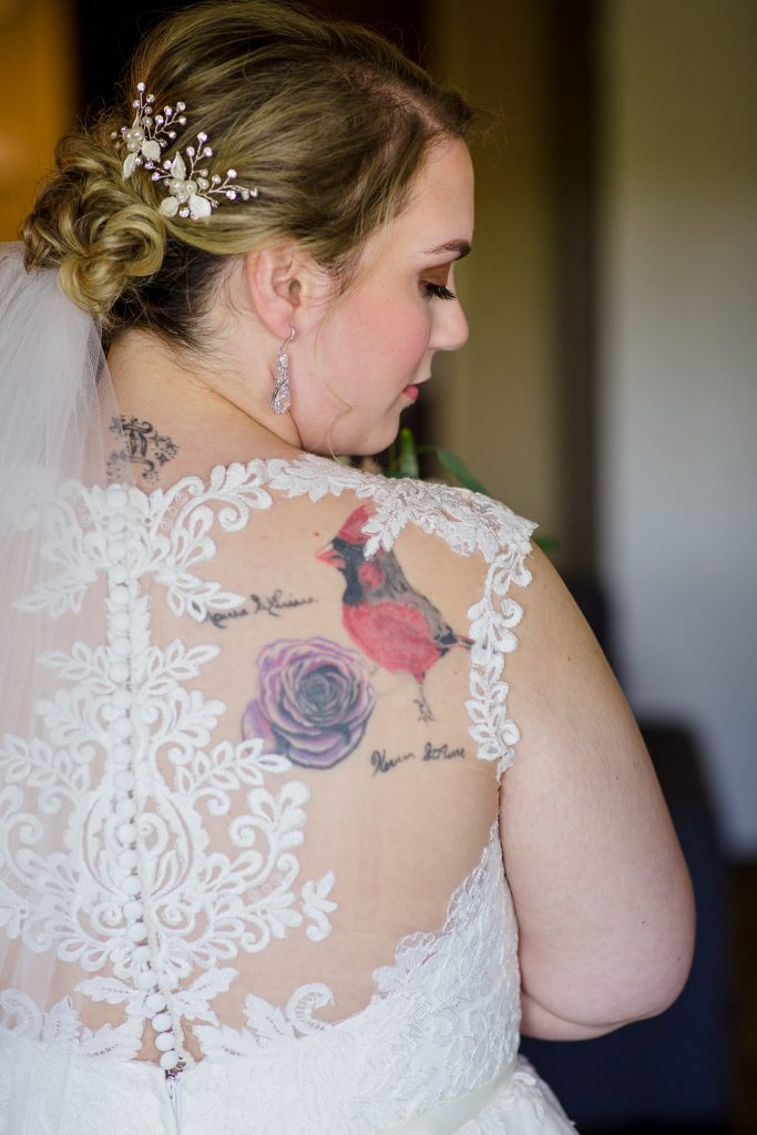 A bride with lacy back dress and tattoos in central MA.